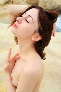 Sweet brunette Night A poses naked on the beach presenting her slender pale body