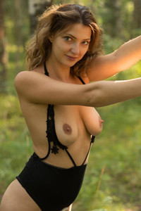 All natural and beautiful Krisin shows us her assets in the forest