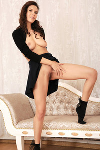 Top class brunette Suzanna A puts up her skirt and spreads her legs to show us her tight pussy