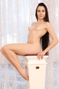 Long haired brunette looks so good while she is spreading her legs in nice posing staff