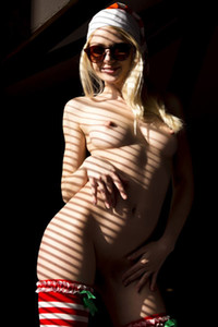 Exotic blonde Nika lets us see her amazing body while she is posing naked sensually
