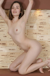 Slim and all natural brunette Rati shows off her naked flexible body at home