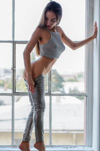 Sexy brunette Gloria Sol is taking your breath away dressed in that tight grey pants