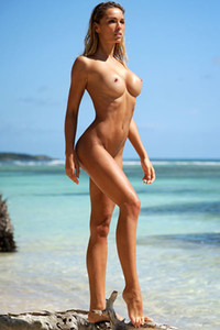 Top class babe Amber A exposes her tanned athletic body on the beach
