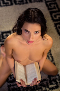 Tempting brunette cutie Jasmine Jazz undresses and reads book naked