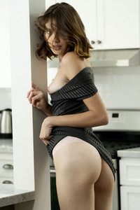 Lonely brunette Lena Anderson is in her kitchen feeling naughty and sexy