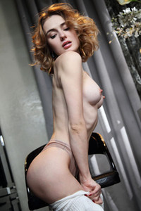Elegant brunette beauty Alice Shea drinks her tea and exposes her smooth pale body