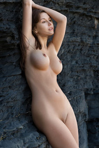 Fabulous brunette Alisa I presents her curvy body and big boobs as she poses on the rocks