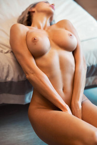 Magnificent busty female Tanita is in her bedroom flashing her astonishing curves