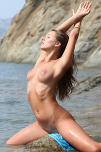 Babe with big nipples Kira A gets naked and shows her mind blowing sex appeal in shallow water