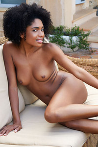 Gorgeous ebony hottie with amazing curves Luna C fingers her trimmed pussy on the couch