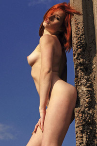 Elis B naked redhead woman flashing with her sexy curves in an abandoned building