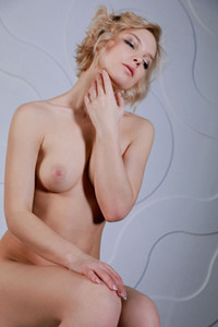 Blonde in transparent white lingerie Hilary Wind dazzles us with her nubile body and smooth skin