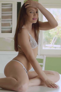Young brunette Janeth Tense is spreading her legs on the kitchen table to leave you speechless