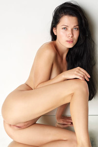 Dark haired beauty Belle poses naked on the mirror floor showing off her sex assets