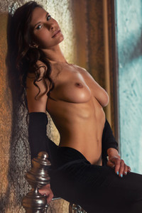 Fantastic brunette Suzanna takes off her black bodysuit exposing her tight body