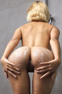 Angelic blonde doll Ariel seductively poses under the shower showing us her nubile body