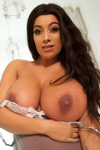 Irresistible brunette Fiona Sciciliano takes off her nightie to show us her extra large breasts