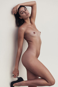 Adorable young girl posing naked in the few very seductive positions showing her amazing body curves