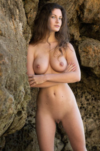 Big titted brunette enjoys sensual solo time on the nude beach