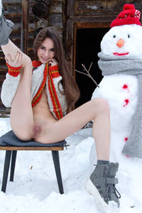 This gorgeous babe Leona Mia is not feeling cold outside on the snow because she is hot