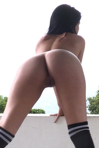 Ana Henao teasingly dancing and showing her perfect rounded ass on the terrace