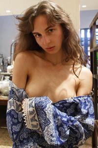 Good looking brunette strips off her bodysuit showing off her medium natural boobs