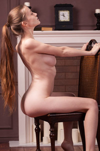 Brunette angel flashing with her sexy curves in the living room