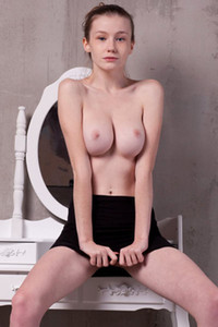 Emily Bloom takes off her blue shirt and black skirt to reveal her secret and sexy assets