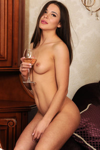 Angelic brunette Lika Dolce takes off her white dress and drinks her wine naked