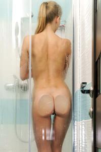 Adorable and playful charmer Elizabeth Evans exposed in Wet Pleasures