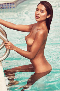 Look at hot young brunette posing naked in the pool giving you a nice view on her superb body shapes