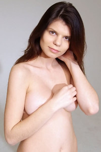 Long haired brunette Davina is hiding her amazing body curves under dress