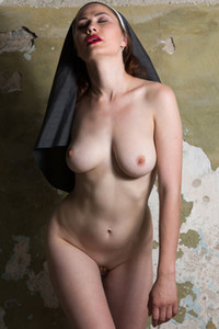 Hot and lustful nun Judith Able takes off her gown and teases her pussy