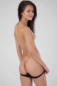 Astonishing girl looks so sexy while she is slowly taking off her tight black bikini
