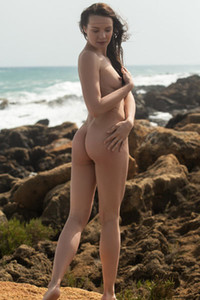 Skinny girl with perky tits and nicely shaped ass poses sensually on the rocks