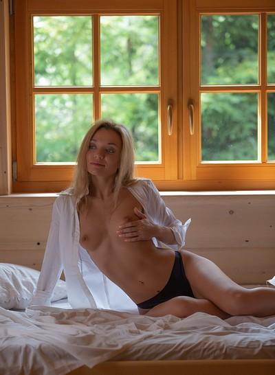 Zhenya Belaya in Bedroom Window from Playboy