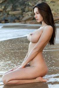 Perfectly shaped brunette Alisa I sensually poses on the beach sand and dazzles us with her beauty