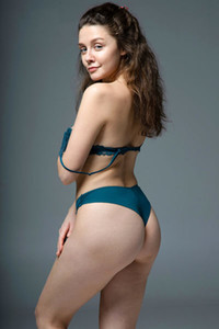 Cute all natural brunette Tina Tee strips off her green underwear revealing her remarkable body