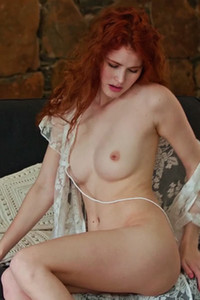 Fantastic redhead girl Adel C strokes her wet pussy on the sofa