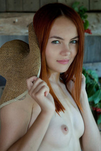Sensual redhead babe Shaya takes off her dress to show us her luscious natural body