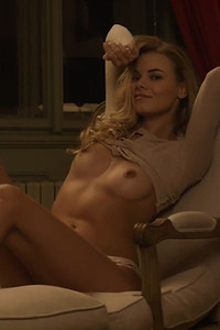 The gorgeous blonde doll she strips her lingerie and shows off her fantastic body on the armchair