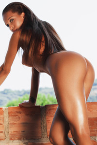 Majestic babe Tyrene shows off her beautiful tanlined body in an abandoned building