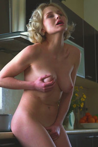 Blonde goddess Kery takes off her sexy clothes in the kitchen and pleasures her sweet pussy