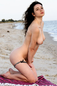 Sweet curly babe Melissa Maz playfully poses naked on the beach