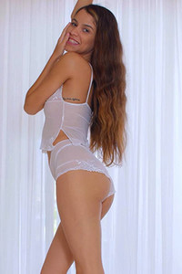 Adorable and playful nubile beauty Katrina Osuna delightfully poses in Sheer Desire