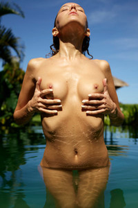 Magnificent brunette Clover poses in the water exposing her sweet tanned body