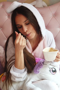 Pretty young brunette Leona Mia is ending her solo performance with a nice cup of coffee