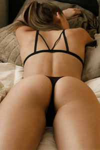 Cute and lovely brunette in sexy black lingerie teasing with her athletic body