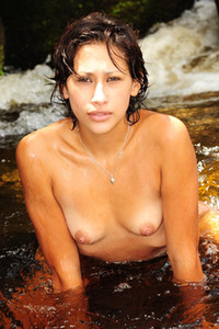 Dazzling babe Cony poses naked in the mountain stream exposing her sex assets